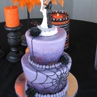 "My First Wedding Cake!   This was for a last minute wedding on Halloween. 6"" orange cream, 9"" chocolate mint; SMBC, MMF."