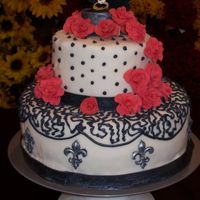 Sogno Di Firenze (I Dream Of Florence) Fondant covered with buttercream dots and cornelli lace. Salmon colored gum paste roses. Gumpaste Florentines w/clear luster dust to make...