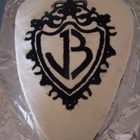 Jonas Brothers This was my first attempt at a buttercream transfer. I shaped the cake to look like a guitar pick and used buttercream for the icing.
