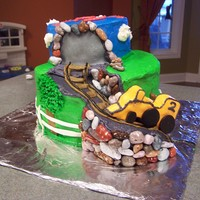 Train Cake This is a spiral cake covered in buttercream. I used fondant for most of the accents. I used chocolate covered rocks for the rock work. I...
