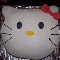 "Hello Kitty This cake was cut out of a 12"" square. I used buttercream with fondant accents."