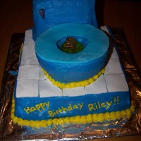 Toilet Cake This was a request from a 5-year-old for his birthday cake. He wanted a blue toilet with poop & pee in it and a moth on top. Notice the...