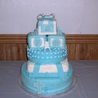 Baby Boy Christening Cake This is a baby boy's christening cake. It made using fondant and gumpaste. For the blocks I used rice crispie treats.