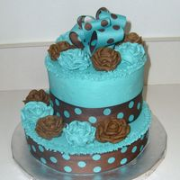 Chocolate Brown & Aqua Bridal/wedding Cake This is a Chocolate Brown & Aqua cake. This is one of the new popular color scemes for weddings. The cake is made of buttercream and...