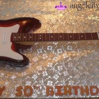 Guitar Cake - Fender Strat We originally made a Fender Electric Guitar Cake just so we could take pictures of it and post them on our website. Within three weeks we...