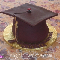 Graduation Cap Cake Here is a graduation cap cake we made using gumpaste for the mortarboard and fondant.