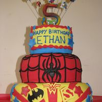 Dc/marvel Superhero Cake This was for my son's 5th birthday party, which I was crazy enough to invite 17 superheros to! It is a 3 layer cake covered in fondant...