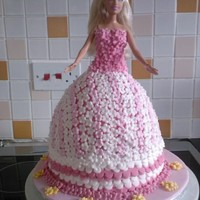 Barbie Cake This is the very first cake i ever made for my niece's 5th birthday. It was a labour of love as it took me 12 hours to make! She is...
