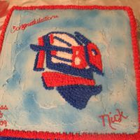 Graduation Cake They wanted his school mascot emblem on the main cake, then two other cakes, one representing his being in football, and one a record...