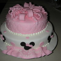 "Minnie Mouse Yet another minnie mouse birthday cake! This little girl loves micky/minnie, but her mom wanted something a bit more ""pretty"" and..."