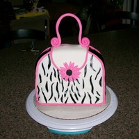 Purse Cake I made this for my cousin's birthday. Its devils food cake with fudge filling and swiss buttercream. She loved it. Unfortunately my...