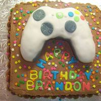 "Xbox Controller Cake Controller made with RKT then covered in fondant. Once all fondant on the cake, hit it with a steamer to make the lettering ""pop&quot..."