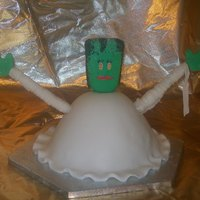 Bride Of Frankenstein Wonder Mold (large) cake pan, 3 marshmallow brooms stuck together with B/C then covered in fondant for head, long pretzels for arms.