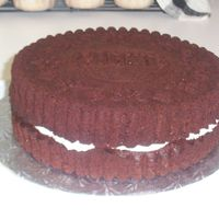 Giant Oreo Cake Cake pan from Williams-Sonoma. Whipped Icing from Wilton in the middle. That's it!