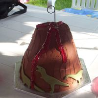 "Volcano Birthday Cake For my son's birthday. Bottom 1/2 is 10"" styrofoam tapered to 8"". Top 1/2 is 8"" and 6"" cakes (offset) carved..."