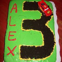 Alex's Lightning Mcqueen Cake Here is my first cake that I have done on my own. The 3 is made with Oreo cookie crumbs( got the idea from other member)