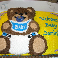 Bear Baby Shower Cake Bear shaped pan on top of a half sheet cake