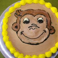 Curious George I made the cake and printed a picture and transfered it with piping gel onto the cake-