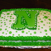 Going Away Cake  This was for my cousin, he was off to collage! so i made him a going away cake, The N was for the collage and their color is Green, and i...