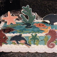 Fish World Birthday Cake I made this for my aunt, she loves that game on facebook, fishworld. so i made abunch of fish out of colorflow.