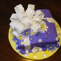 Purple Bow Cake I made this for my grandma, she had people coming to town. its a fondant cake with a bow and some daisy.