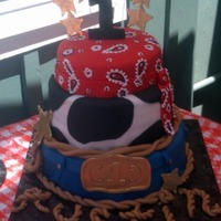 Cowboy Cake Fondant covered cake with gumpaste buckle and sheriff's badges