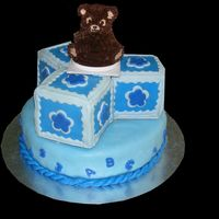 Baby Blue Bear is chocolate cake with chocolate butter cream icingblocks and base are yellow cake with raspberry filling, butter cream frosting and...