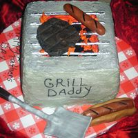 Bbq Cake I made this cake for my dad for fathers day 2009. I wanted to do something different .He loved it so did everyone else. Everything is...