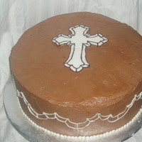 Funeral Cake Cake for my uncle's funeral. Mocha cake with chocolate BC filling. Chocolate transfer cross, with chocolate piped on the sides.