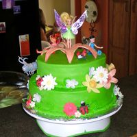 Tinkerbell Cake Buttercream cake with gumpaste flowers and figures. My first stacked cake and my first time working with gumpaste. I was quite happy with...
