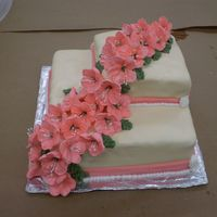 Wilton Class 3 Cake is covered with fondant. Petunias are in Royal Icing. Border made with buttercream icing. Colors used: peache, ivory, juniper green...