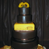 3Rd Wedding Cake  3rd wedding cake for SIL's brother. Sunflower themed yellow and brown cake. 4 round styro tiers and square is chocolate cake,...