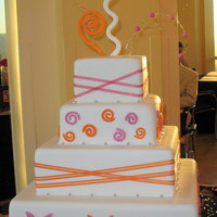 Orange And Pink Wedding Cake This was for my cousin's wedding. She wanted something fun and her colors were pink and orange. She absolutely loved it!