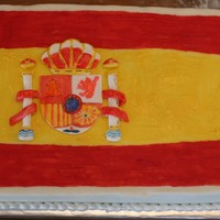 Spanish Flag Cake This cake was covered in fondant and the flag was painted on using melted candy melts in various colors. The decoration was formed from...