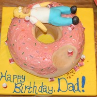 Homer Simpson On Donut Cake This cake was not perfect but the recipient was happy with it. That is all that matters.