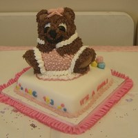 Baby Bear This cake has a 10 inch square base, with the 3D bear pan on top. Bottom tier is covered and decorated in fondant, blocks are made of...