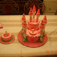 Princess Rylee's 1St Birthday! This was for my best friends daughter's 1st birthday! They wanted a princess themed cake. I got the idea for this cake from the Wilton...