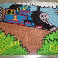 Thomas The Tank Engine  This was for my son's 5th Birthday. I found a picture in his Thomas the Tank Engine Magazine and drew it free-handed onto the cake and...