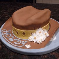 Howdy Pard'ner Cowgirl Hat Cake I made this instead of one of the cakes recommended for the final Wilton Fondant and Gumpaste class--way more fun!