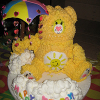 "Funshine Carebear Cake Stacked 6-6"" round chocolate cakes, covered in butterncream. Arms, legs and ears made with Rice Krispie treats, umbrella made with..."