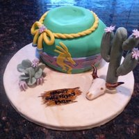 Southwestern Pottery And Scene This was a cake for my mom's birthday. She loves southwestern culture and decor, so I used a small round cake beneath 2 oval cakes to...