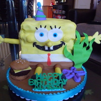 Carved Spongebob Cake Many many layers of chocolate cake, used an ice cream scoop to make ragged edges. Crabby pattie made from cupcake covered in fondant with a...