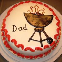 Dad's Day  White fondant over cherry-chocolate cake, with ganache filling. Buttercream around edges color is reddish-orange like flame-red, didn'...