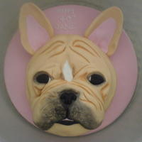 French Bull Dog victoria sponge cake with vanilla buttercream and raspberry jam covered in fondant icing.