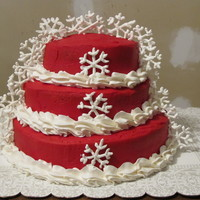 Snow Flakes Red Velvet cake with BC icing. Snow flakes are made of Royal Icing.