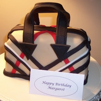 Purse Cake This is the Burberry inspired cake I made for my daughters birthday. It was a red velvet cake with cream cheese frosting for a filling,...