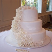 White Ruffled Wedding Cake Inspired by a bridal magazine photo of an oval cake designed by Condra Easley of Patisserie Angelica. There were three cake flavors, carrot...