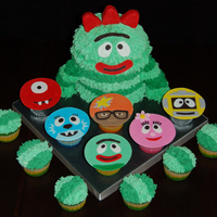 "Yo Gabba Gabba Brobee made using 6"" round cakes and 1/2 of the Wilton ball pan. Covered with buttercream icing and fondant facial details. Arms and..."