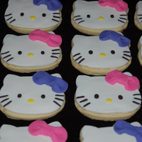 Hello Kitty Cookies Birthday Cookies for a friend's daughter who loves pink and purple (and Hello Kitty, of course) Made to go with a rollerskating Hello...