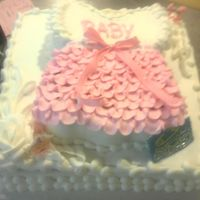 Baby Dress   shape cake with patterns and ruflles in buttercream,